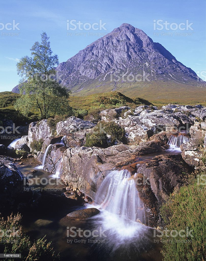 Buchaille Etive Mor and waterfall stock photo