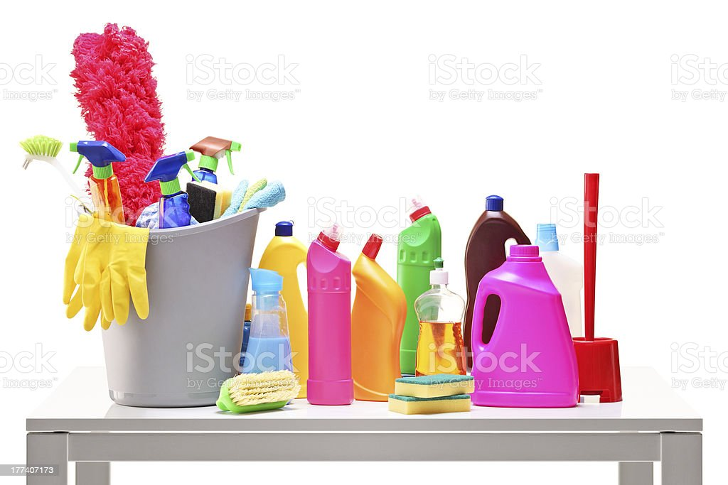 Bucket and cleaning supplies on a table stock photo