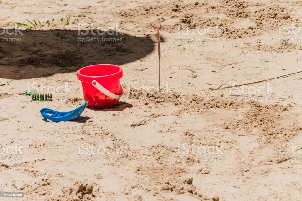 Bucket and other sand toys on a beach stock photo