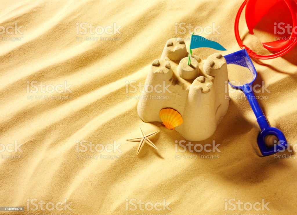 Bucket and Spade with a Sandcastle stock photo