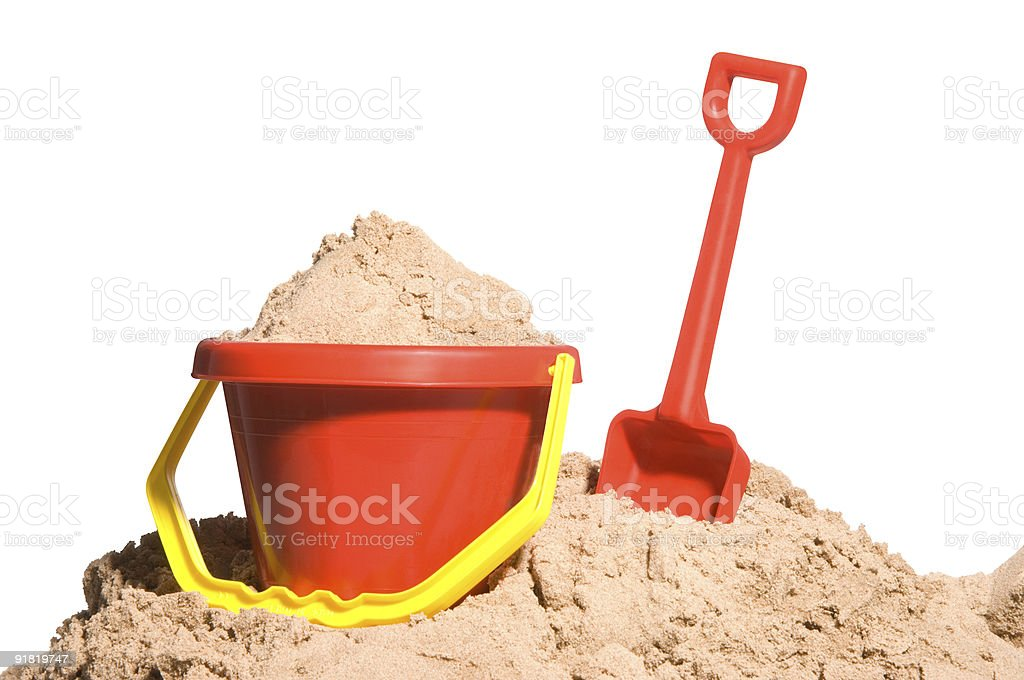 Bucket and spade with sand stock photo