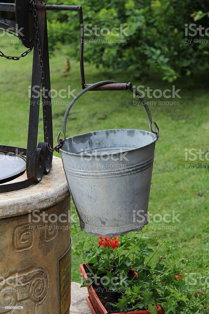 Bucket at the well stock photo