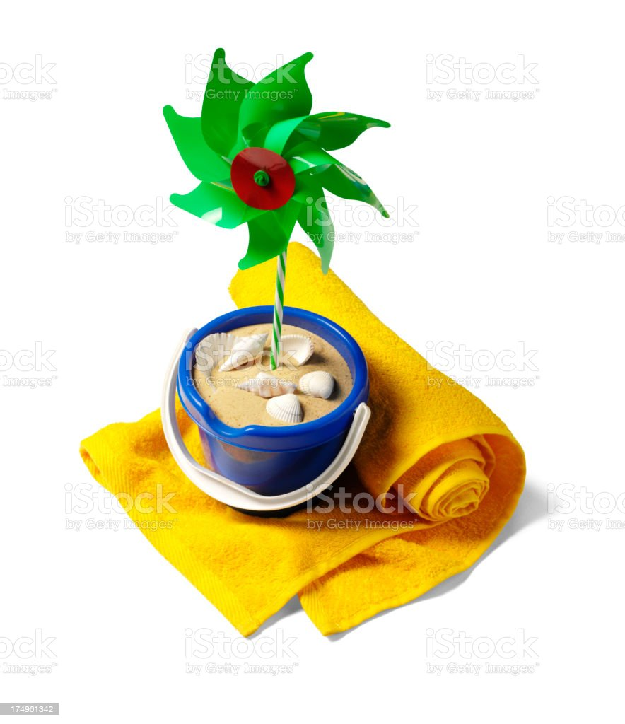Bucket, Beach Towel and Toy Windmill royalty-free stock photo