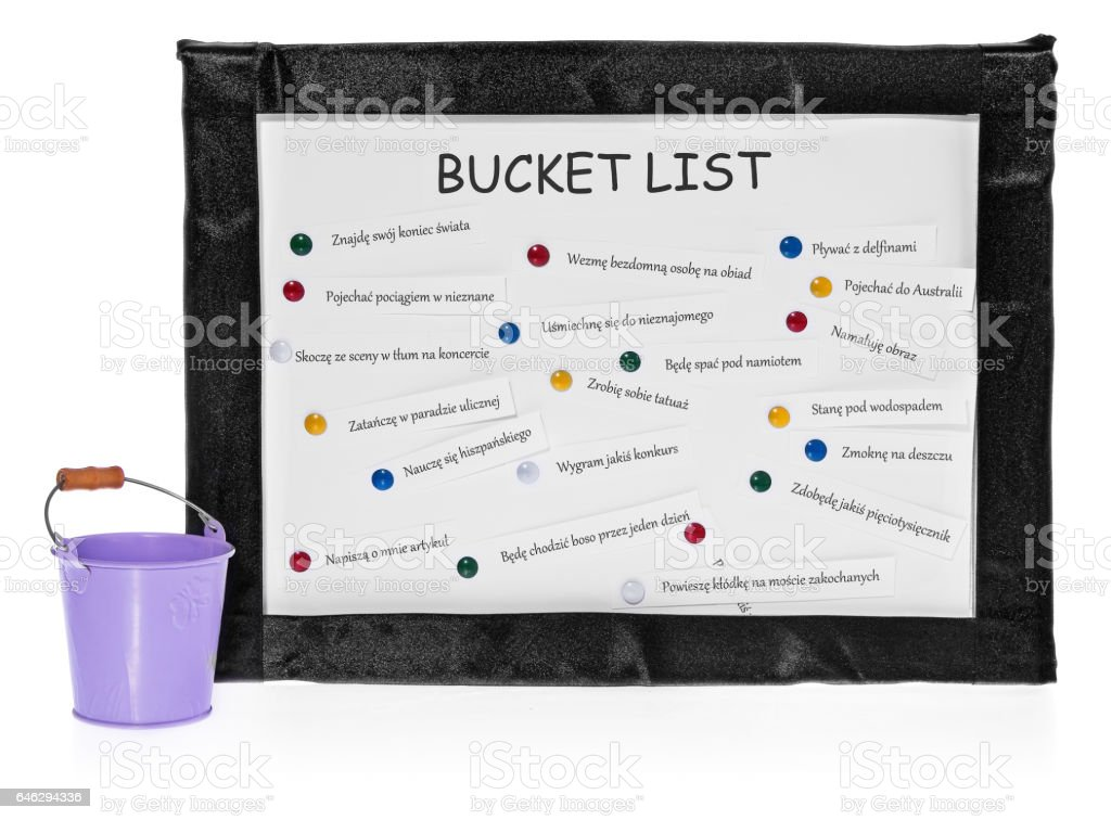 Bucket lists on the board and bucket on completed tasks. stock photo