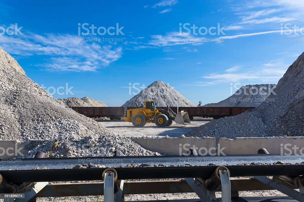 bucket loader loads the clay stock photo