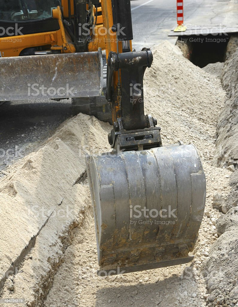 bucket of a bulldozer during the digging stock photo