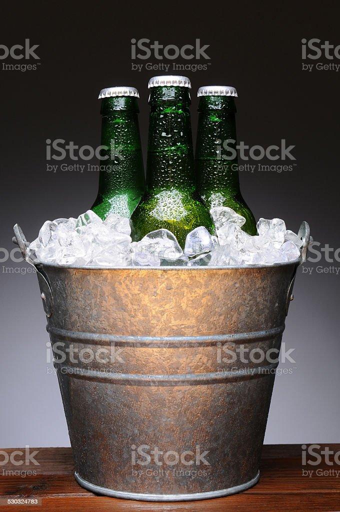 Bucket of Beer on Wood stock photo