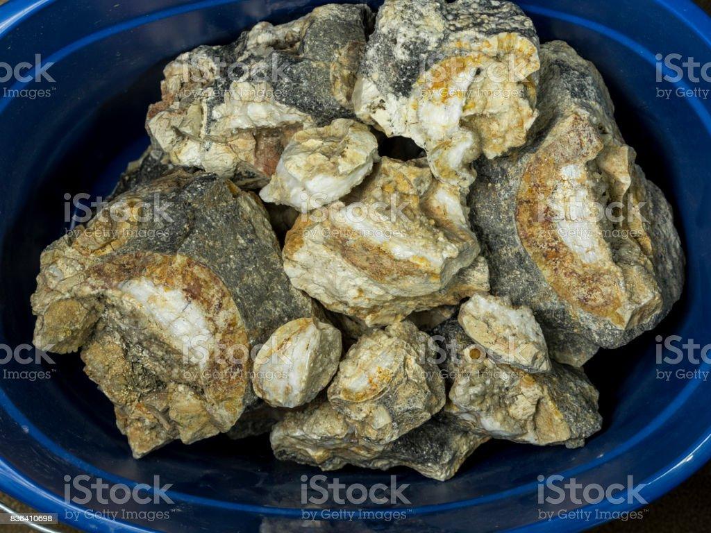 Bucket of Rocks Opal Uncut Gemstone from Mine in USA stock photo