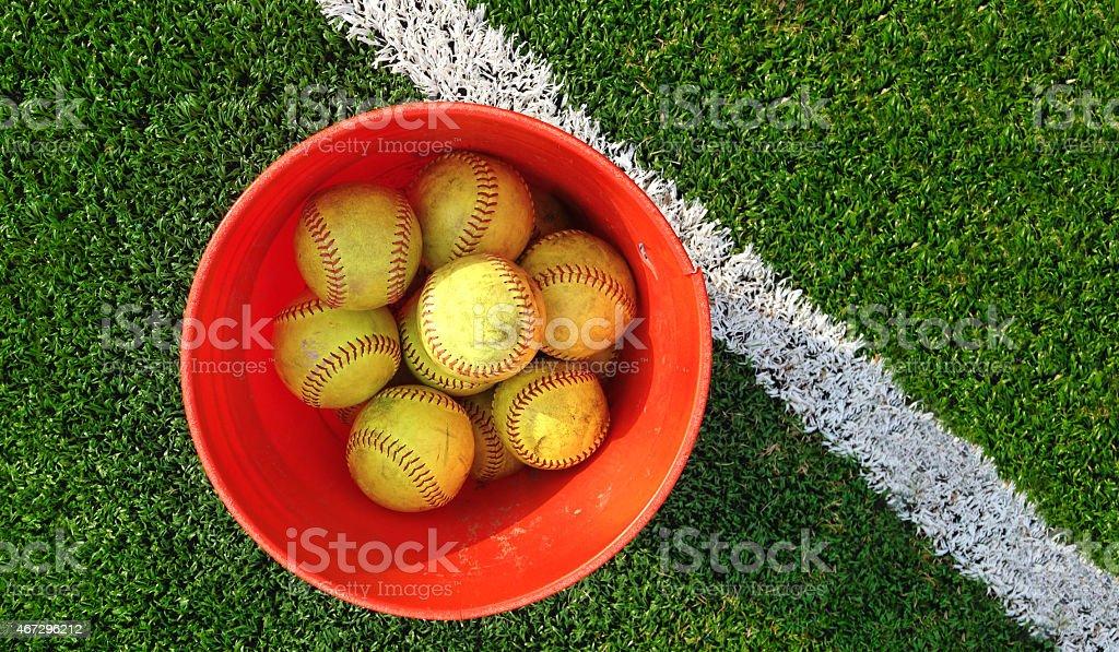 bucket of softballs stock photo
