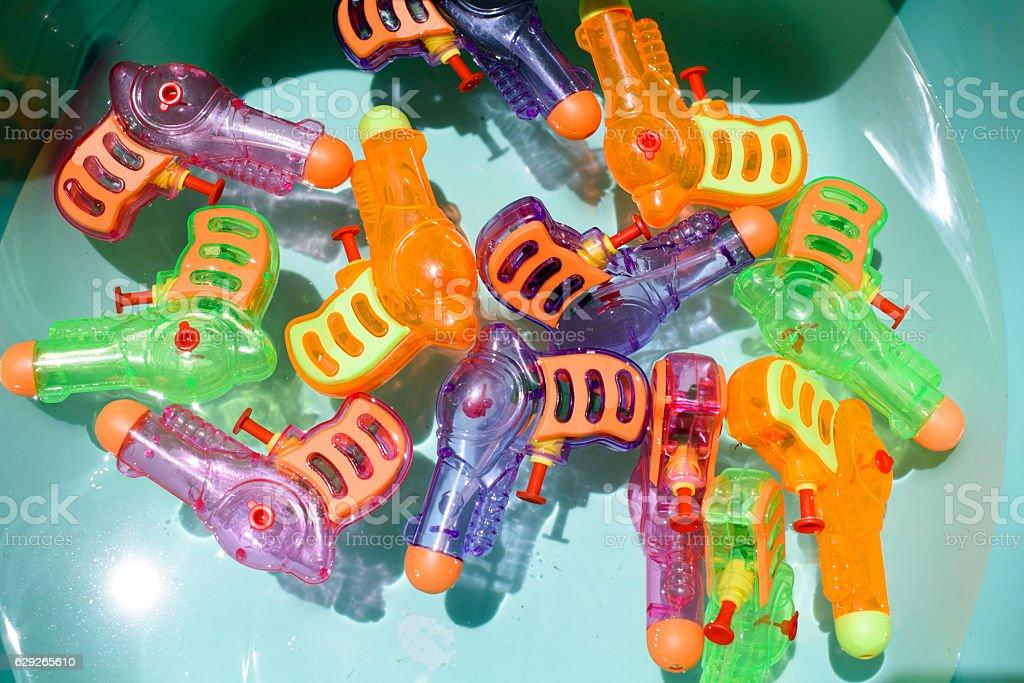Bucket of Squirt Guns stock photo