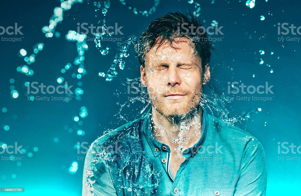 Bucket of water hits a man in the head stock photo