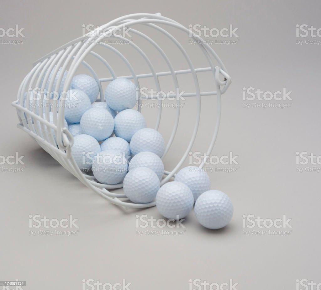 Bucket of White Golf balls stock photo