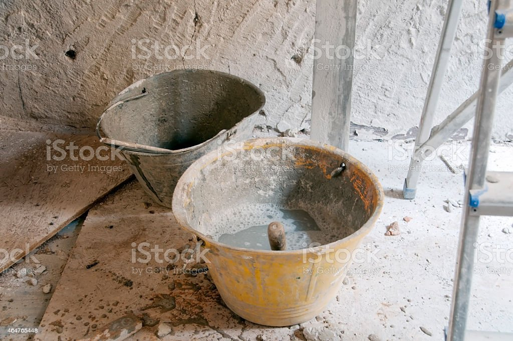 Bucket to mix the cement stock photo