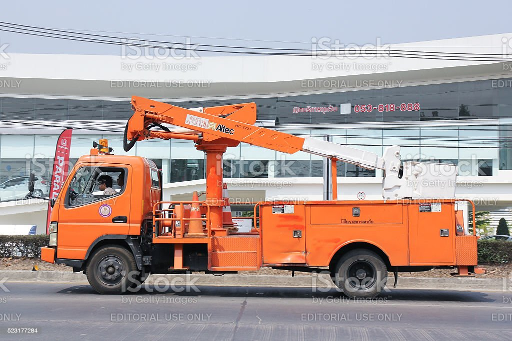 Bucket truck of Provincial eletricity Authority of Thailands. stock photo