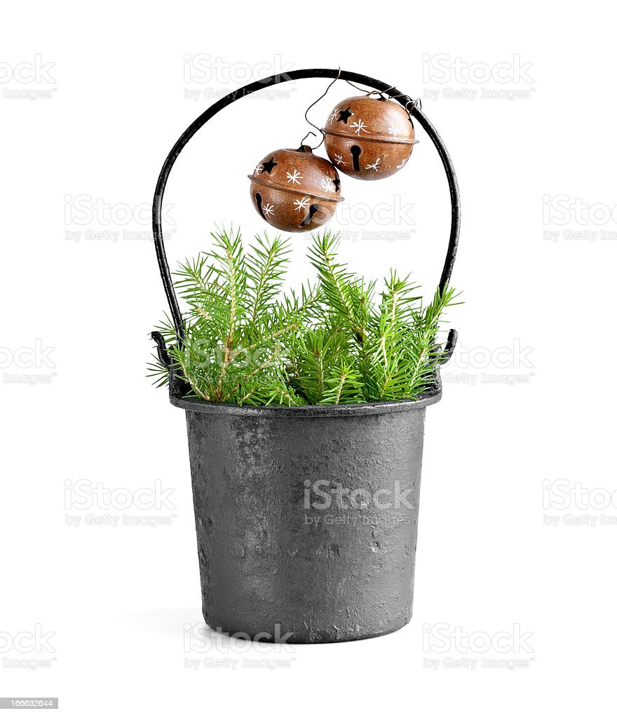 Bucket with fir tree branch and sleigh bells royalty-free stock photo