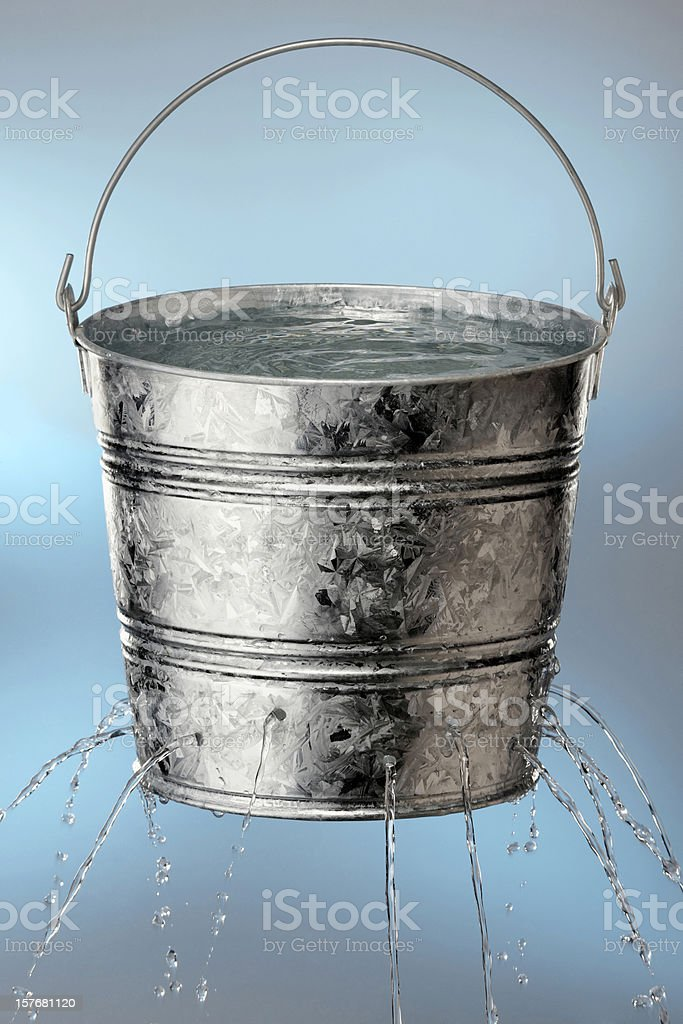 Bucket with holes leaking water royalty-free stock photo