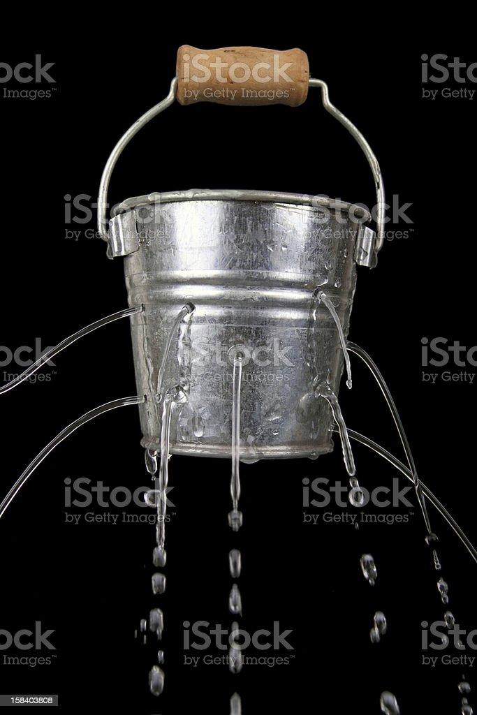 bucket with holes stock photo