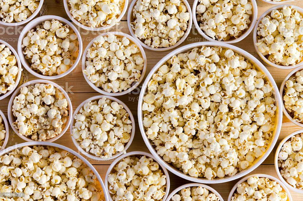 Buckets full of freshly made popcorn for everyone stock photo