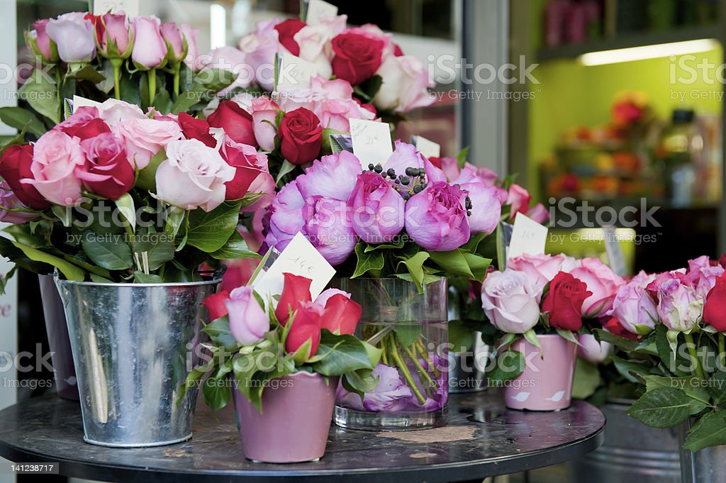 Buckets of fresh pink and red roses outside a florist shop stock photo