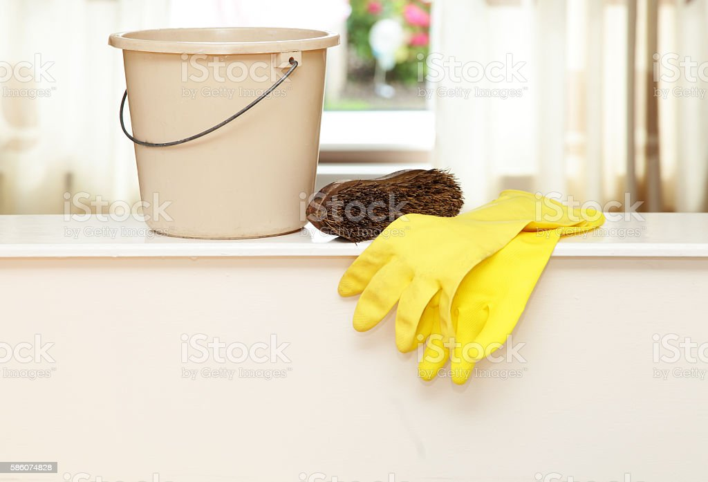 bucket,scrubbing brush and plastic gloves stock photo