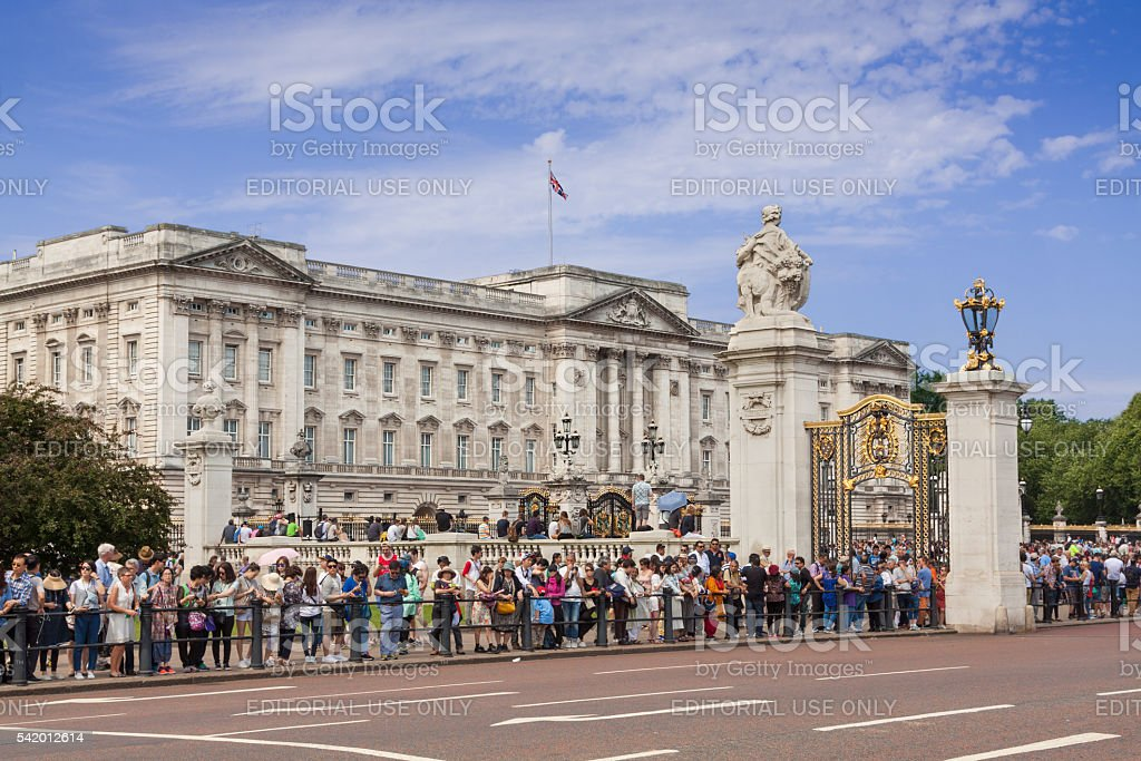 Buckingham Palace and tourists waiting for Changing the Guard, London. stock photo