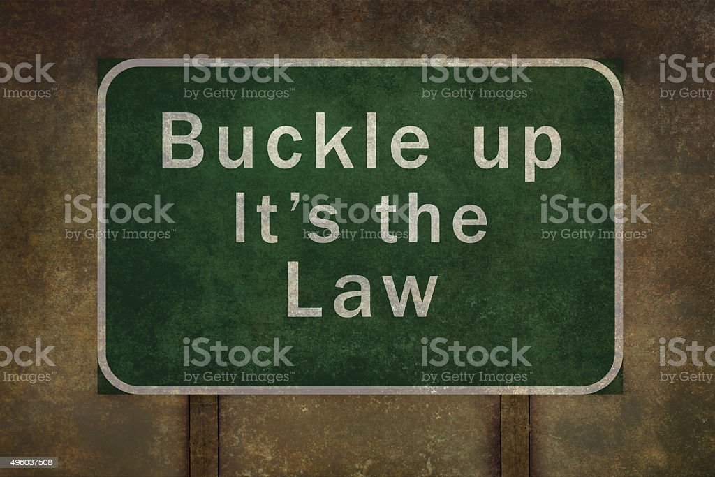 'Buckle up its the law' roadside sign illustration stock photo