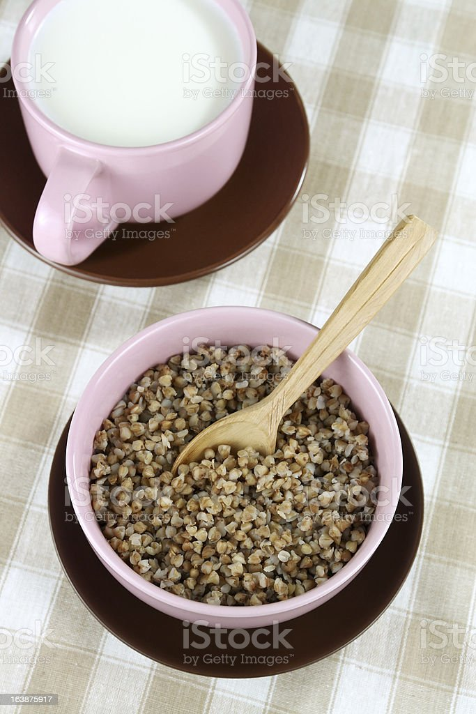 Buckwheat and milk in a cup royalty-free stock photo
