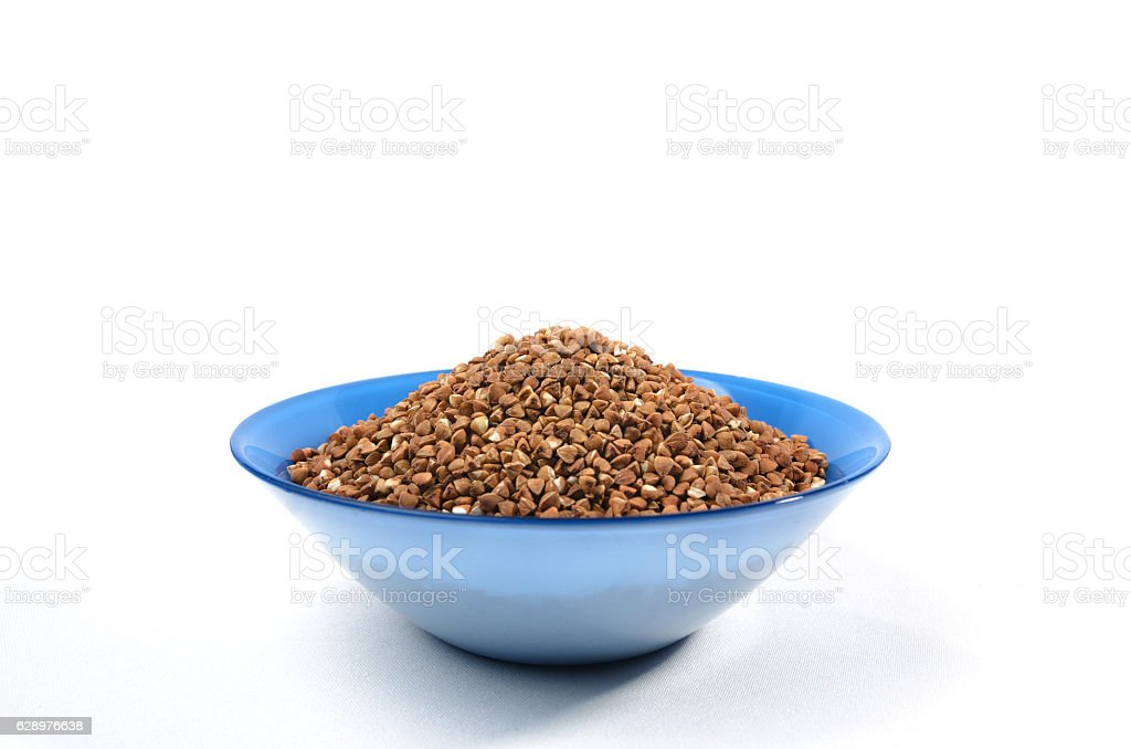 Buckwheat grains from above isolated on white background stock photo