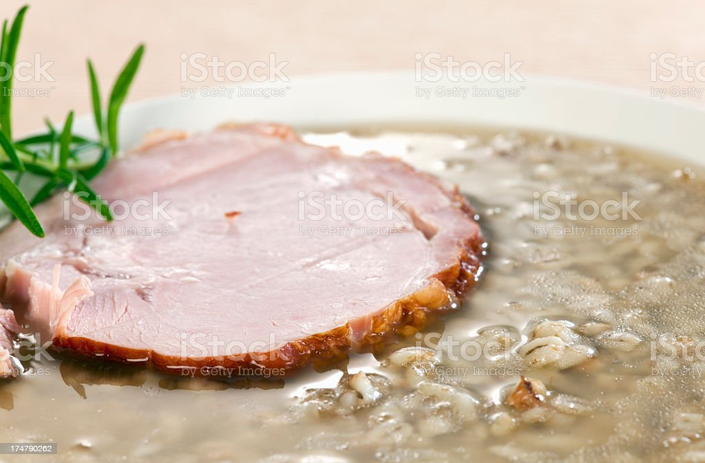 Buckwheat groats soup with smoked meat stock photo