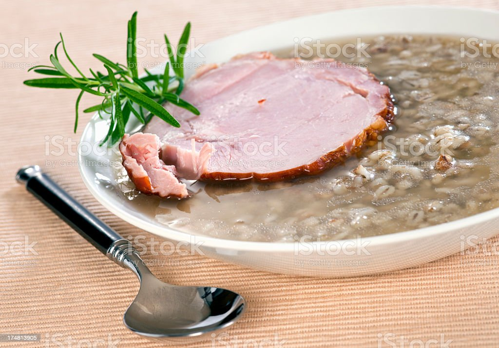 Buckwheat groats soup with smoked meat royalty-free stock photo