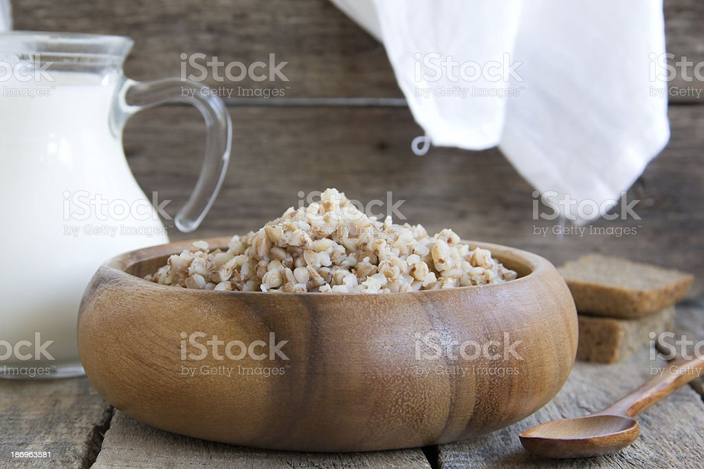 buckwheat in a wooden plate. royalty-free stock photo