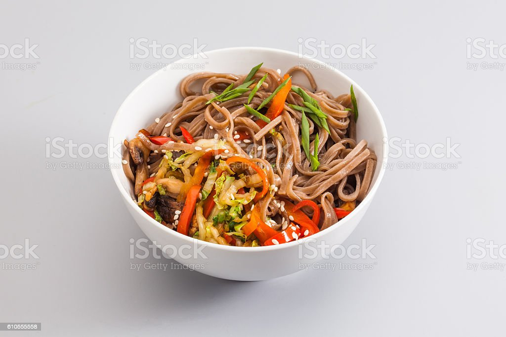 Buckwheat noodles bowl with fried vegetables and shiitake mushrooms. dish stock photo