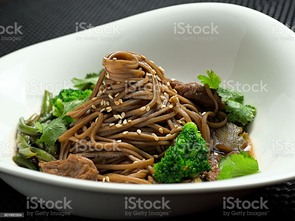 Buckwheat noodles with chicken and vegetables in Japanese style stock photo