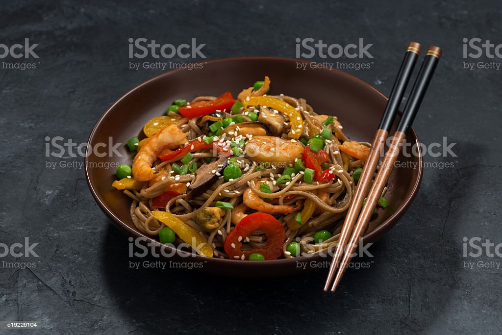 Buckwheat noodles with seafood in a bowl stock photo