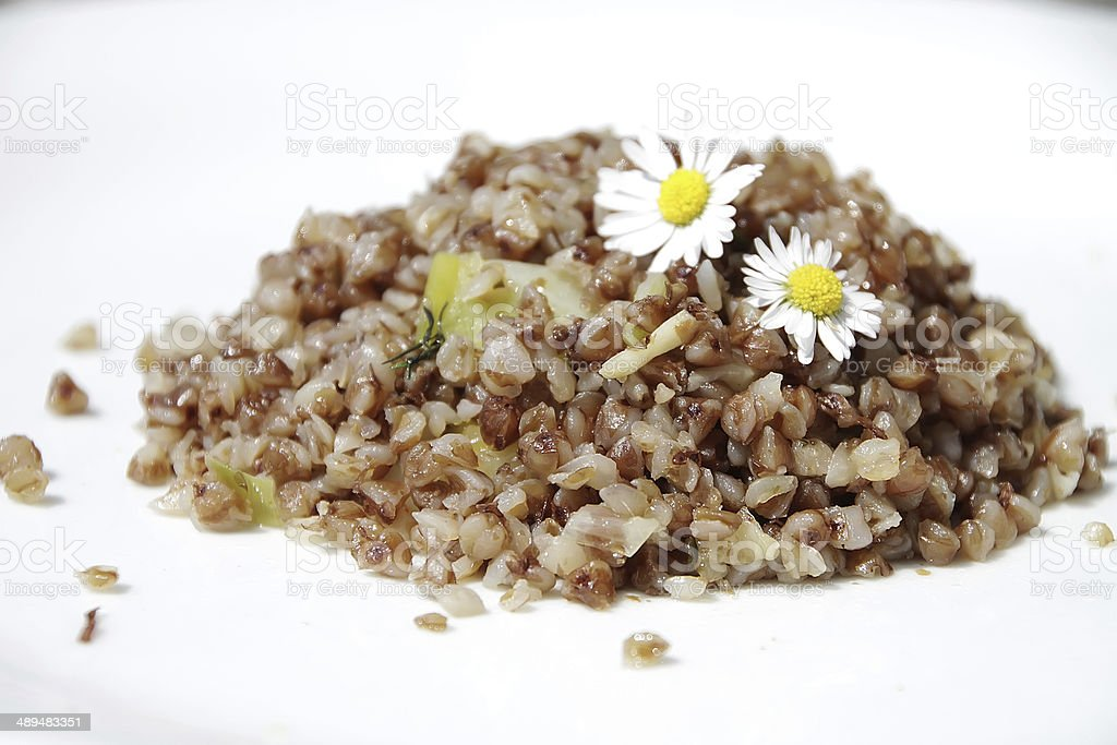 Buckwheat on white backgrounds stock photo
