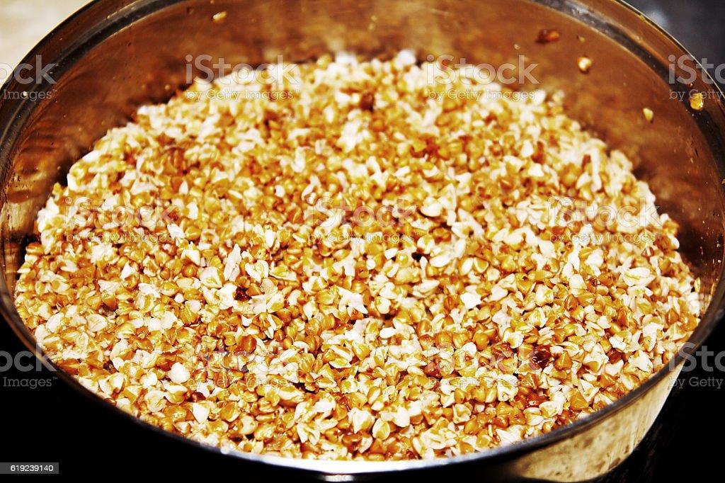 Buckwheat porridge in the pot stock photo