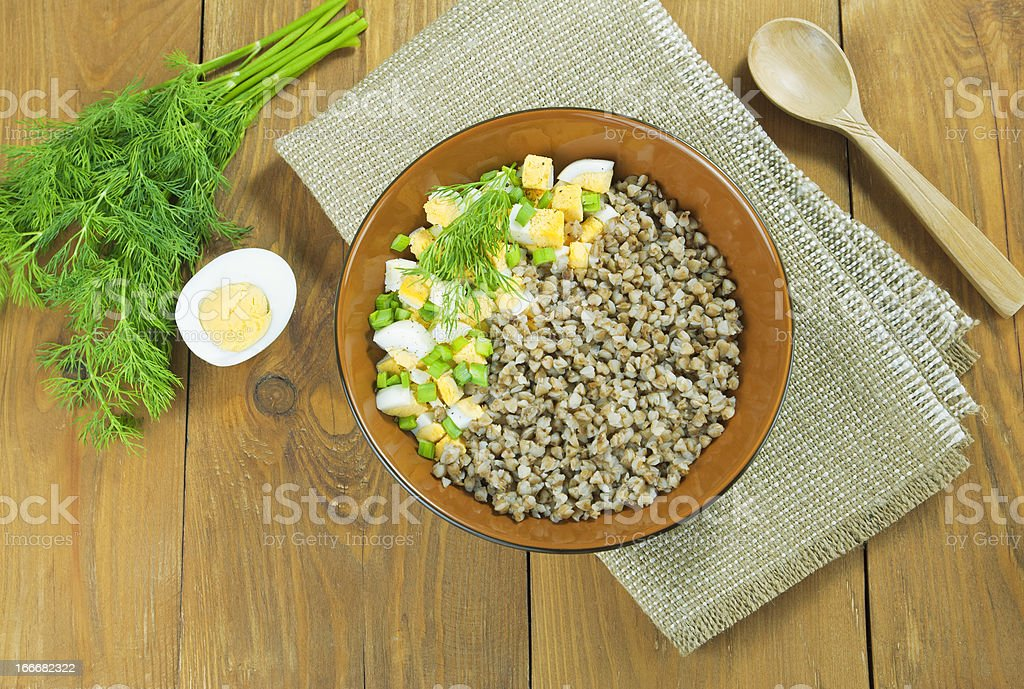 Buckwheat porridge with eggs and herbs royalty-free stock photo