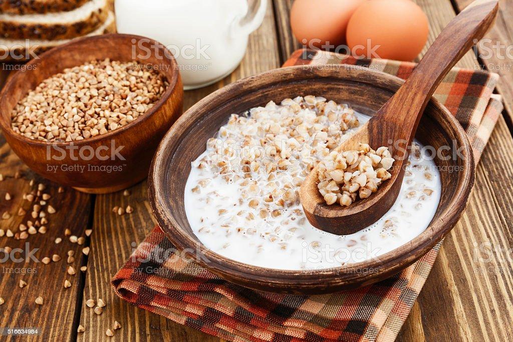 Buckwheat porridge with milk stock photo