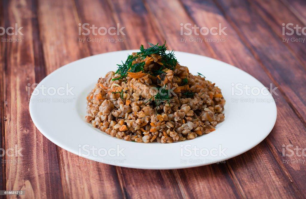 Buckwheat porridge with vegetables and meat stock photo