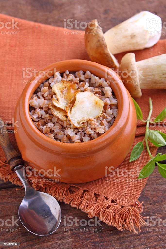 buckwheat porridge with white mushrooms stock photo