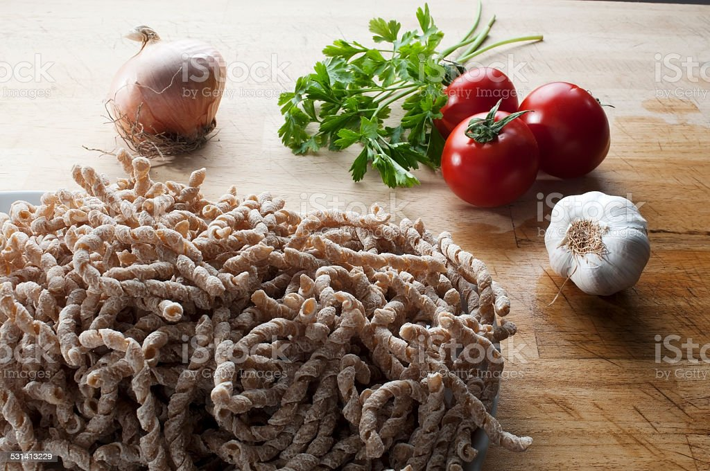 buckwheat raw pasta with flavors stock photo