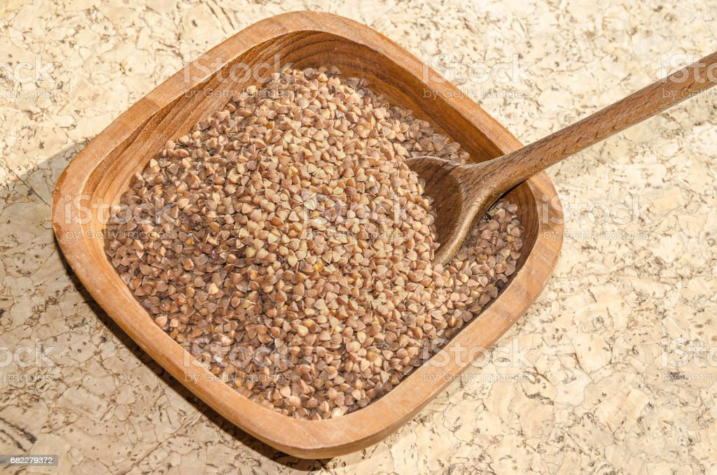 buckwheat seeds in a rustic wooden shell stock photo