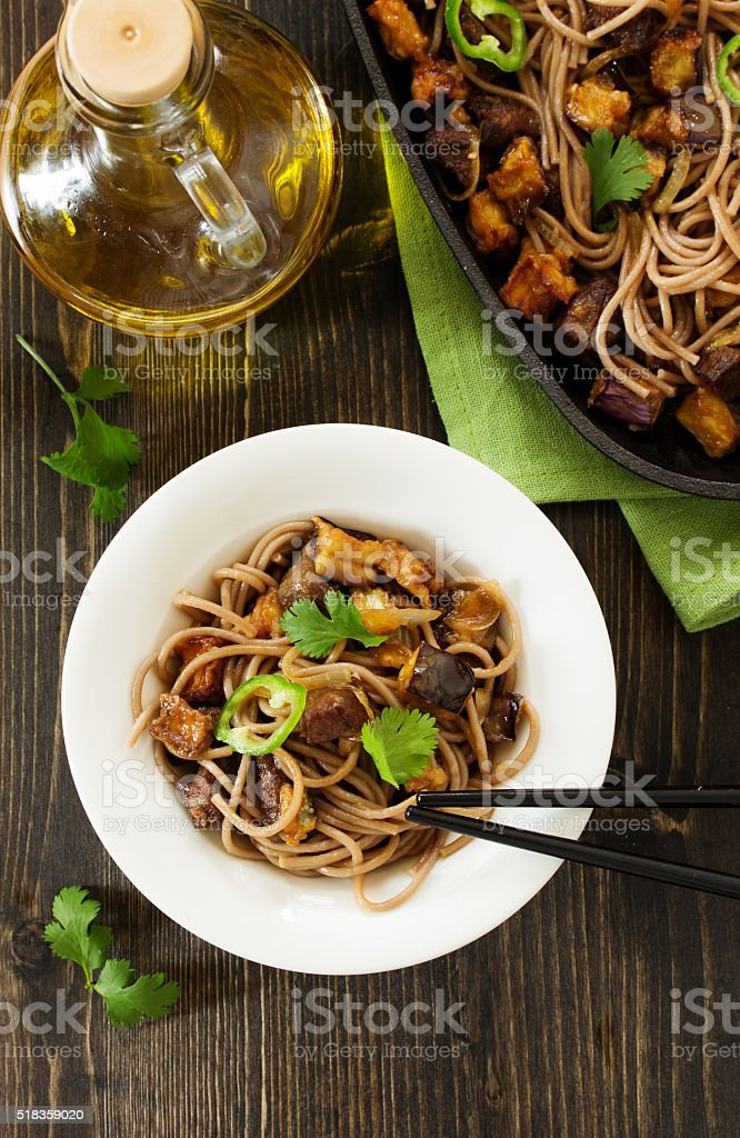 Buckwheat soba noodles with beef and eggplant. Asian cuisine. stock photo