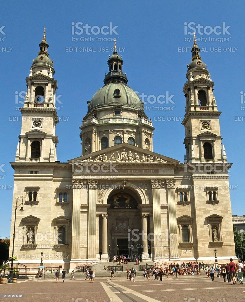 Budapest, Hungary St. Stephen's Basilica tourists in square sunny day stock photo