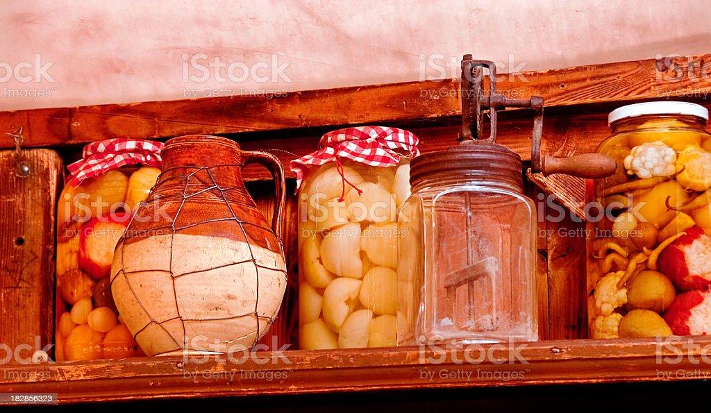 Budapest Kitchen Preserved Food Jars and Churn on Shelf stock photo