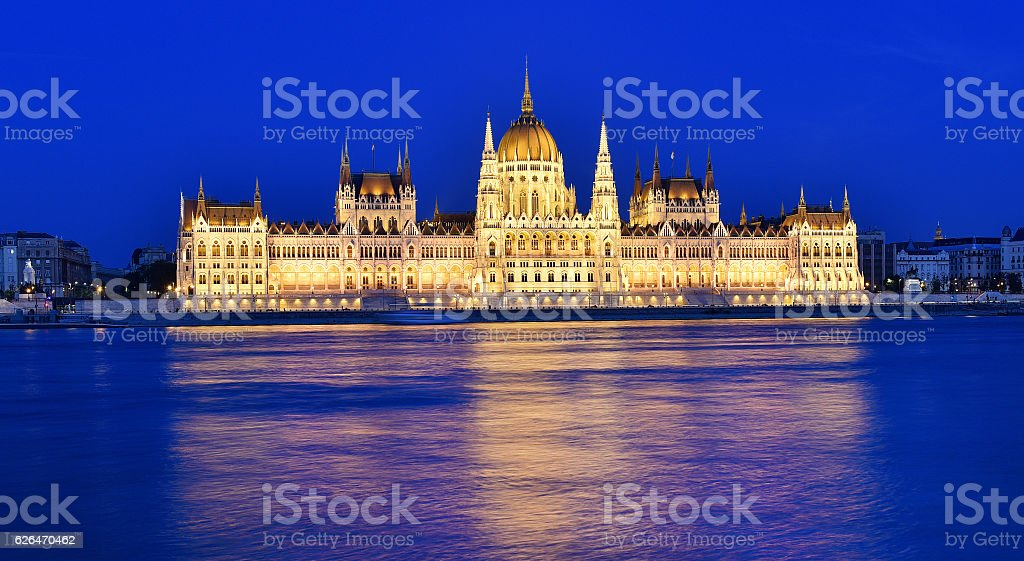 Budapest parliament at blue hour near the Danube river stock photo