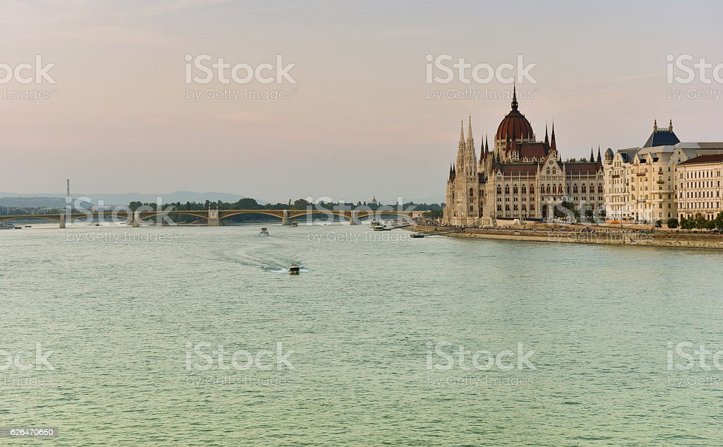 Budapest parliament at sunset near the Danube river stock photo