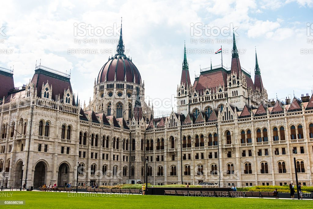 budapest parliament morning day tourists clouds sun stock photo
