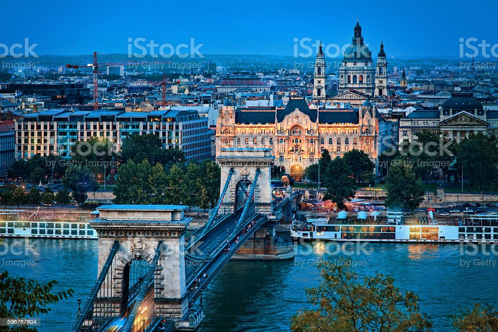 Budapest - Széchenyi Chain Bridge and the illuminated Gresham Palace stock photo