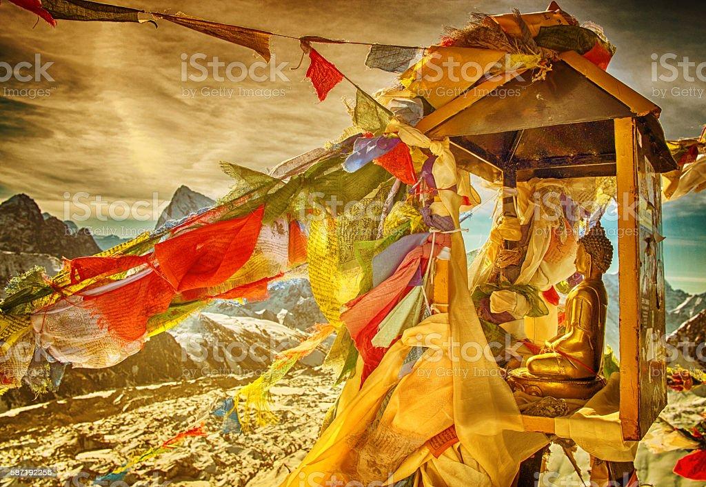 Budda statue on mountain Gokyo Ri. Himalayas, Nepal stock photo